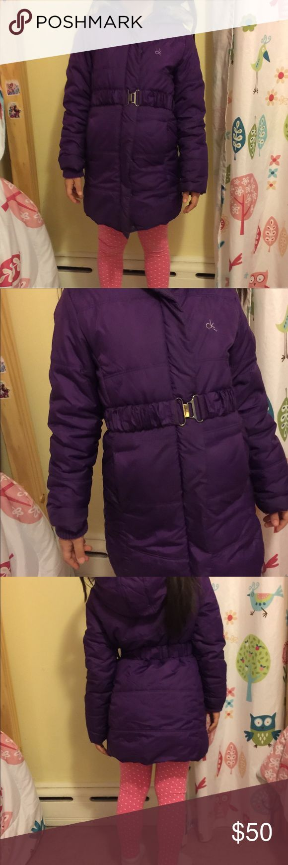Calvin Klein coat Purple coat was purchased at Burlington coat factory with a stain on the back of the coat. My daughter barely used it. It's in almost new condition. You cannot see the stain when worn. Look at the last pictures please. Size 6-7 Calvin Klein Jackets & Coats Puffers