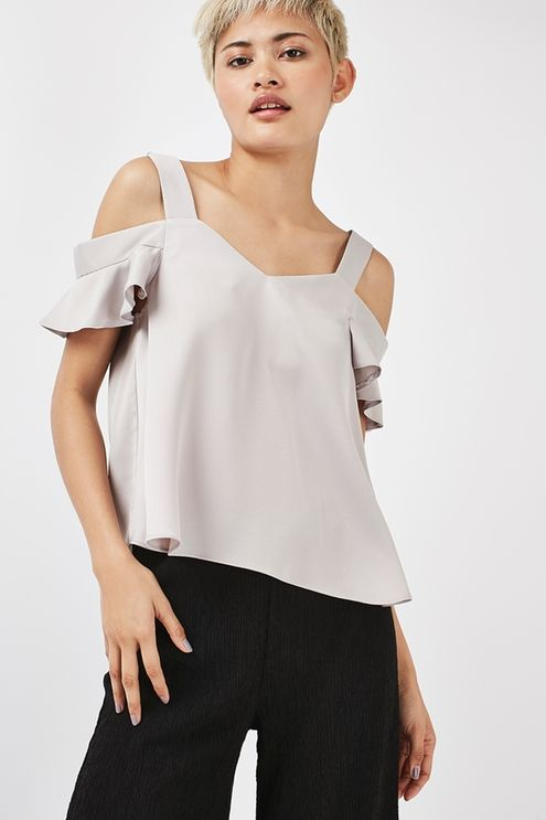 Keep shoulders on show for a look that is so now in this silver satin cold shoulder frill top. We love the frill detail and flattering draped silhouette. Work it with denim for a cool finish. #Topshop