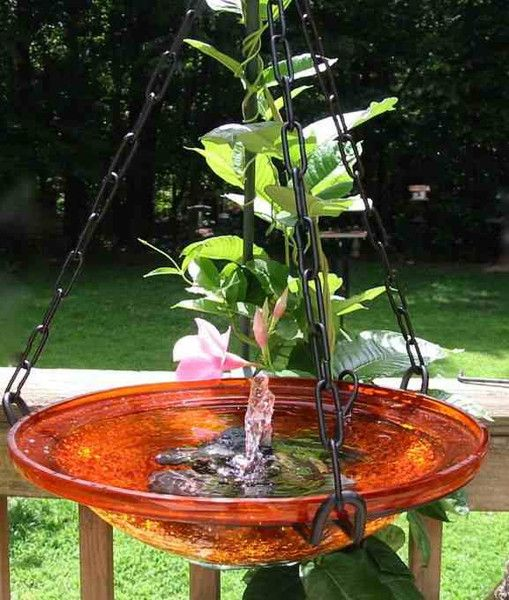 Hanging bird bath with solar power bubbler entices feathered friends for bathing and fun time! Glass bowls feature rich color and sturdy iron hanging ring. Moving water stays fresher- costs nothing to