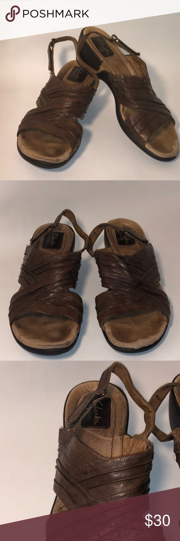 Clark's Artisan Size 9 Brown Sandals ** Clark's Artisan Size 9 Brown Sandals** -GUC -size 11 -color: Brown -back Velcro tie for the perfect fit -super comfortable  -all day walking sole -comes from a pet and smoke free home 💗NO TRADES💗 Clarks Shoes Sandals