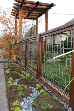 Beautiful utility panel fence design. Less costly than the full wood fences, and it would look great around the garden.