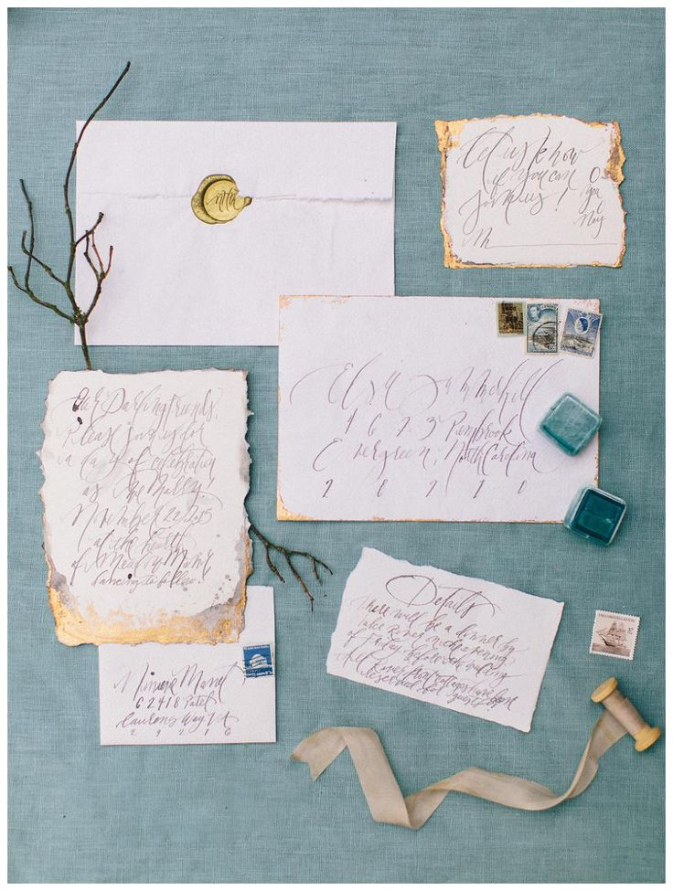 Calligraphy wedding invitation suite on deckle edge paper with gold details by Bohemian Ink. Image by Perry Vaile Photography.