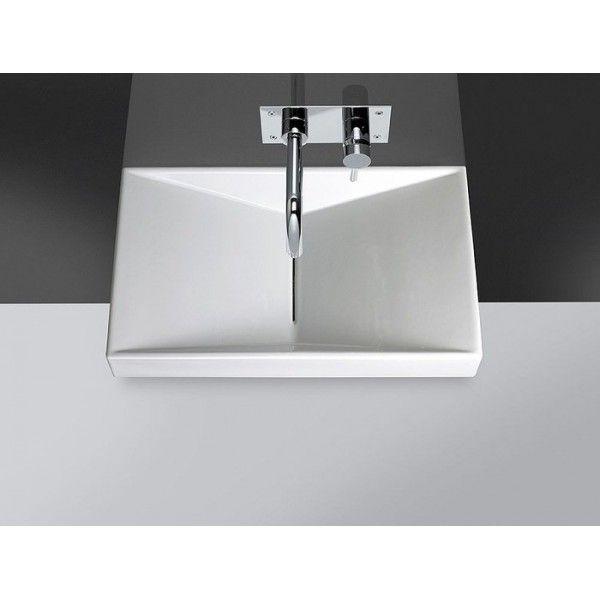 Plan vasque suspendu de 65cm avec vidage intégré dans la masse pour un design moderne....