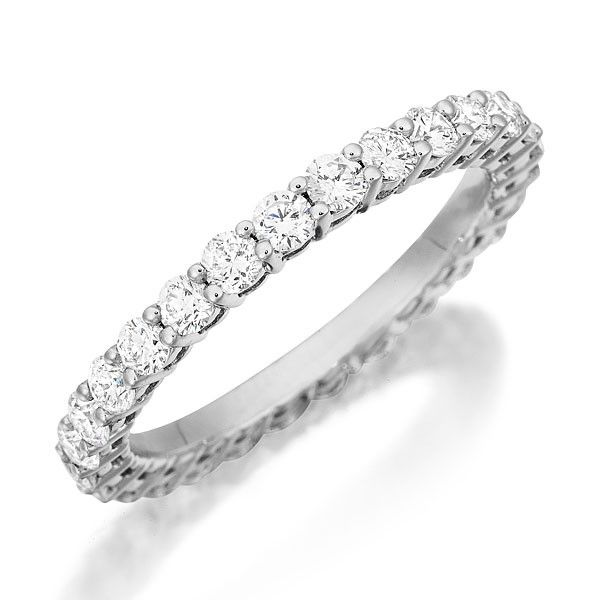 Henri Daussi R7 Wedding Ring  Henri Daussi shared prong diamond wedding band. This gorgeous wedding ring features a single row of hand-matched diamonds. Band is available with diamonds either halfway around or all the way around.