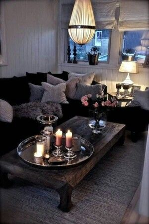 "All the ambiance looks cozy and elegant due the big ""noir"" side sofa"