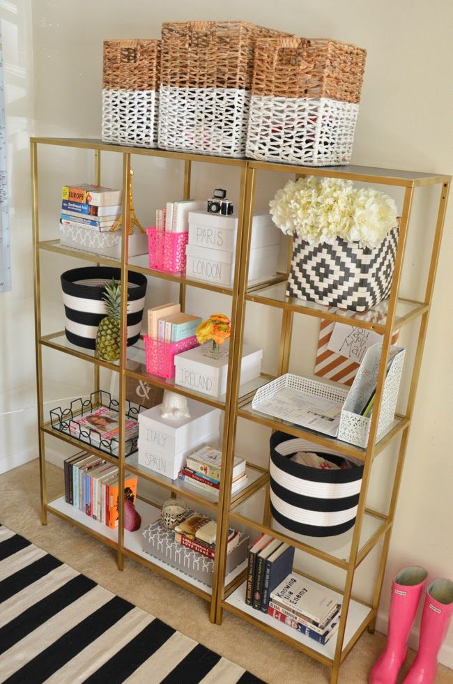 Bookcase | Ikea ( painted it from black to gold) Rug | Homegoods loving this one Baskets ( on top) | Homegoods similar Baskets ( Black/White) | Target  Monogram Letters | Anthropoloige Pink Baskets | Target ($1 section) White Travel Boxes ( DIY) | Michael's similar Grey Boxes | Homegoods Flower arrangement | Target Gold Glass Tray | …