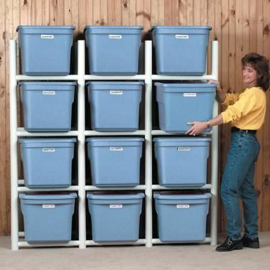 The PVC Bin Storage Center can be built to store any shape and size bin. Build  a PVC frame for plastic storage bins! No need for unstacking your bins when you need the Christmas boxes that are wayyyy down at the bottom of the stack!  For one day when we have a garage.