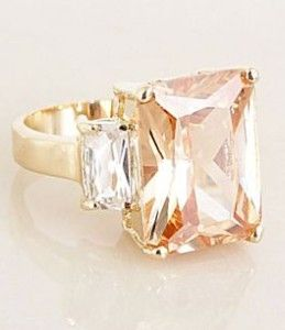peach champagne sapphire center with diamond baguettes....me like