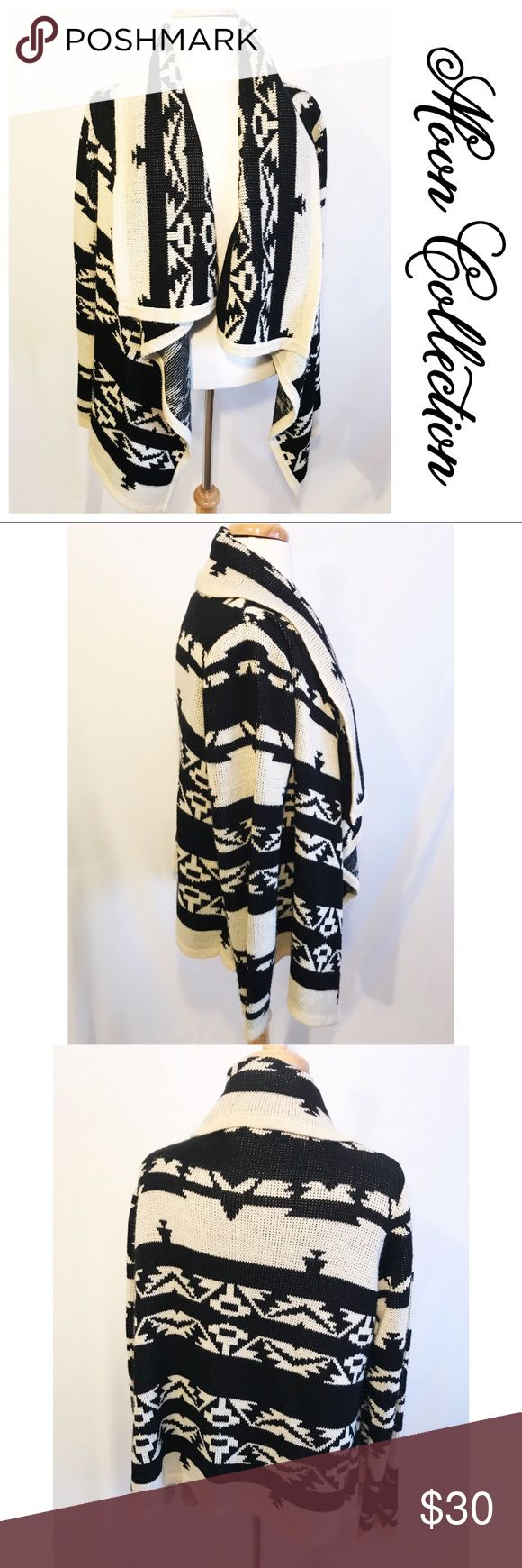 Moon Collection Cardigan Awesome cream and black tribal print cardigan.  Heavier knit like a nice cozy blanket.  Long sleeves and wide foldover collar and lapels.  Great with leggings and boots.  Wonderful item to add to your winter collection Sweaters Cardigans