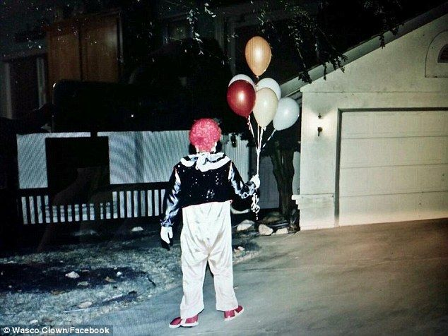 A mysterious clown stands near a home in Wasco, California, as the creepy trend…