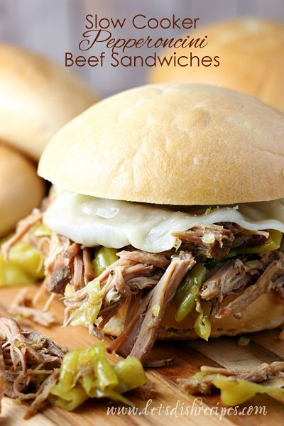 Slow Cooker Pepperoncini Beef Sandwiches Recipe | Super easy shredded beef sandwiches, topped with cheese, are full of flavor and perfect for dinner or game day!