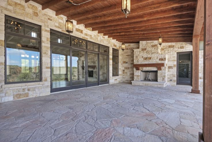Our door living area.  Pine ceiling, fir columns, stone fireplace, flagstone floor.  Built by Olson Defendorf Custom Homes, Austin, Texas.