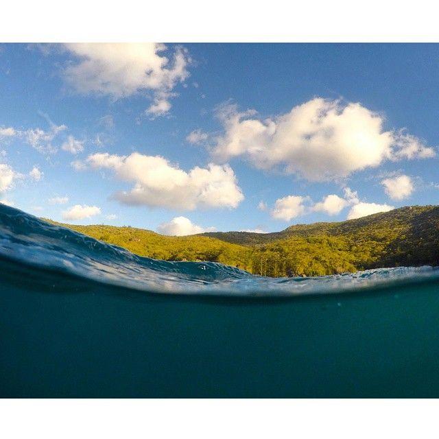 Over & under shot of Whitsunday Islands. #GrabYourDream #Australia #Queensland #travel #adventure #island #sand #traveler