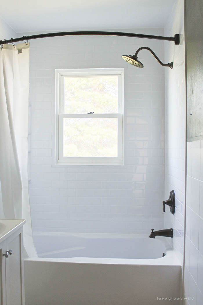 This tub and shower gets a total transformation! See how @BathFitter gave this old farmhouse bathroom a fresh, new look. (via LoveGrowsWild.com) #GetBathFitted #ad