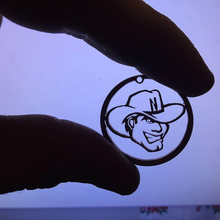 CornHusker Mascot cut into Kennedy Half Dollar