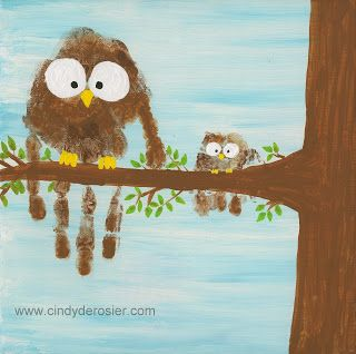 The handprints of two children on a canvas: older brother and baby sister. First paint canvas all blue (or desired color). Then handprint the kids around the middle of the canvas. Use paint to turn the handprints into owls and add a painted tree. Easy nursery decor. You could do the same with handprints of mom and dad and new baby.