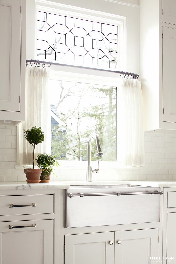 farmhouse sink, marble counters, and decorative window
