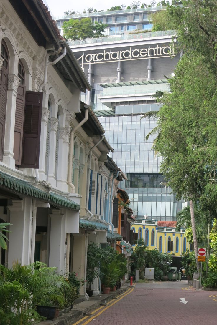 Contrast: a row of colonial-era houses leading down to the shopping paradise of Orchard Street in Singapore.