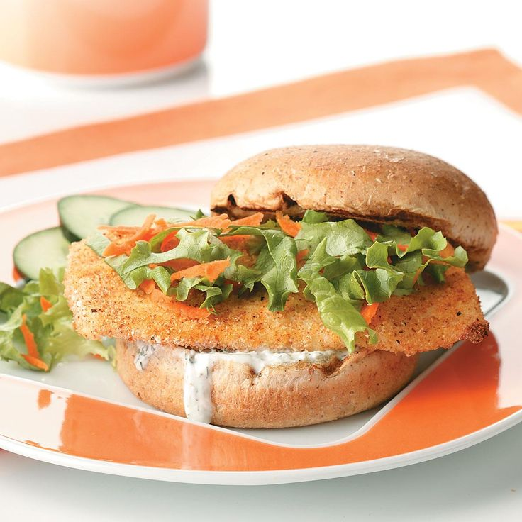 Breaded Fish Sandwiches Recipe -The seasoned breading of this hearty sandwich turns mild-flavored cod or halibut into a taste sensation, and the creamy sauce just keeps it going! Mildred Caruso - Brighton, Tennessee