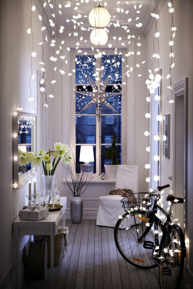 ikea hallway lights. sooo pretty these snowflake string lights with star lanterns!