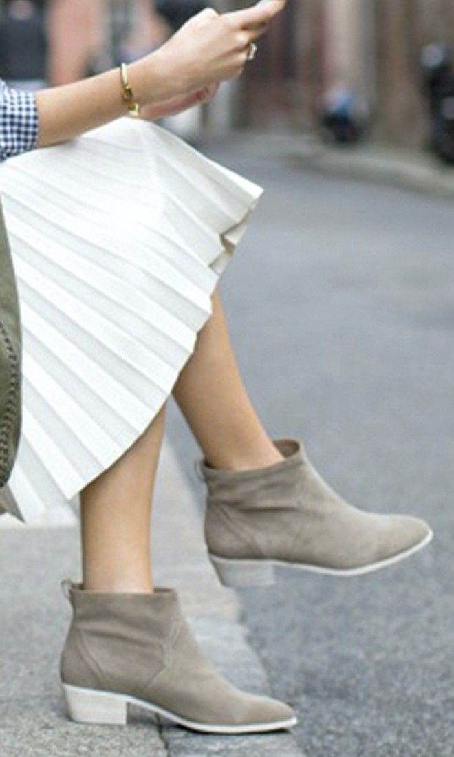 Suede western-inspired ankle bootie in fennel with a relaxed slip-on shape and stacked low heel