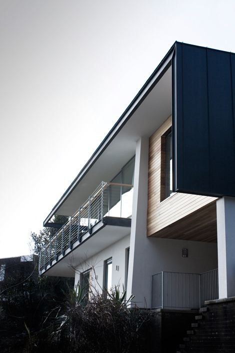 Idle Rocks is an existing quintessential 1960′s modern house perched high on a hill with panoramic views of the ocean and Langland Bay.