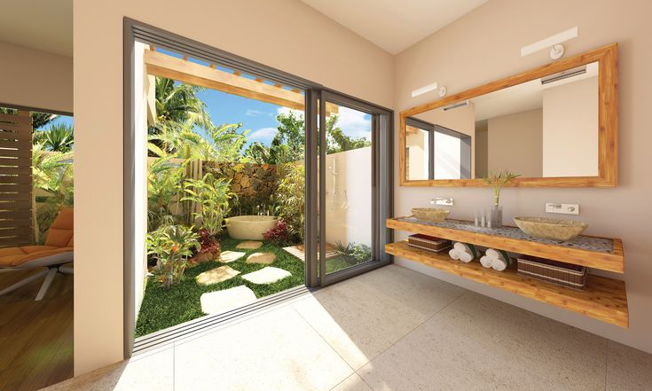 Lovely Tropical Outdoor Bathroom Floating Double Vanity Stone Vessel Sink Beige Tile Floor Wicker Storage Basket White Free Standing Bathtub Palm Tree Chrome Faucet Natural Stepping Stone Small Garden. ➤To see more Luxury Bathroom ideas visit us at www.luxurybathrooms.eu #luxurybathrooms #homedecorideas #bathroomideas @BathroomsLuxury