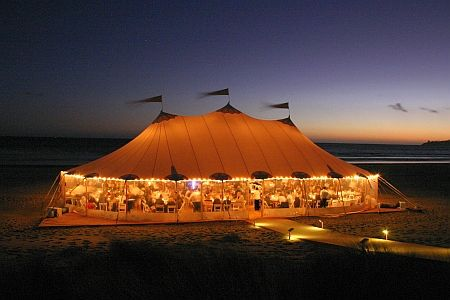wooden walkway and path lighting- zephyr tent.  I want to go to this party!