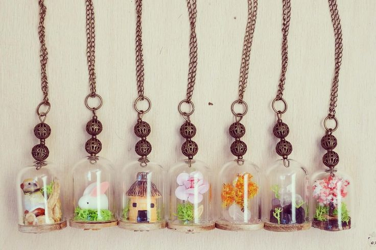 Handmade glass dome necklaces filled with symbolic items