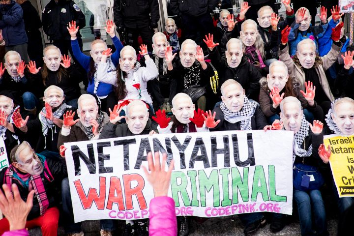 Activists with the organization CODEPINK block the doors of the Washington, DC, Convention Center during Netanyahu's AIPAC visit, 3/15
