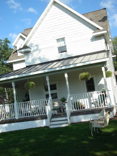 Love Metal Roof Over Patio With Shingles On House