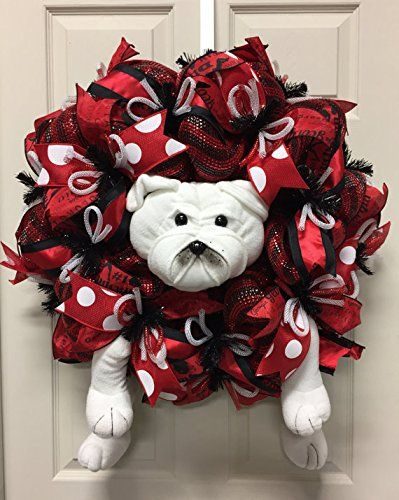 Georgia Sports Wreaths, GA Bulldog Wreath, Georgia College Wreaths. Hang this super cute Georgia Bulldog sports wreath on your front door to show your support for your favorite team. This wreath was made on a deco mesh work form with deco mesh, decorative ribbon, flex tubing and a Bulldog in the center. This wreath is approximately 24 inches in diameter and 8-9 inches deep. Add this shop to your favorites to see what is new each week. Thank you for stopping by Wreaths by Robin.