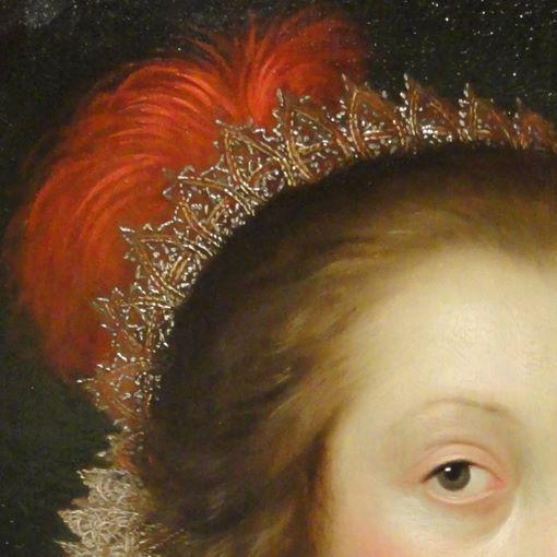 Cornelis Janssens van Ceulen. Ritrotto di signora. Olio su tavola del 1619. Cleveland Museum of Art. Sulla sommtà della testa un ricco diadema cattura la luce: da dietro, legata ai capelli raccolti sulla nuca, spunta una folta piuma rossa.
