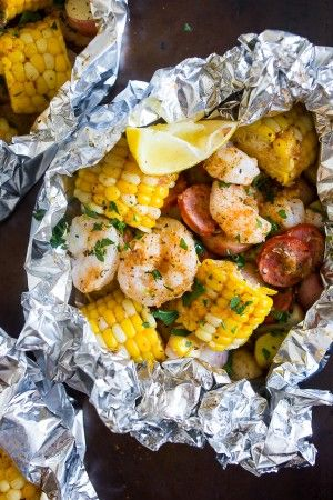 These low country boil foil packets are a breeze to make and packed full of flavor. Potatoes, corn, andouille sausage and shrimp all together in an easy foil packet that you can bake in the oven or throw on the grill. You'll love this flavorful dish!