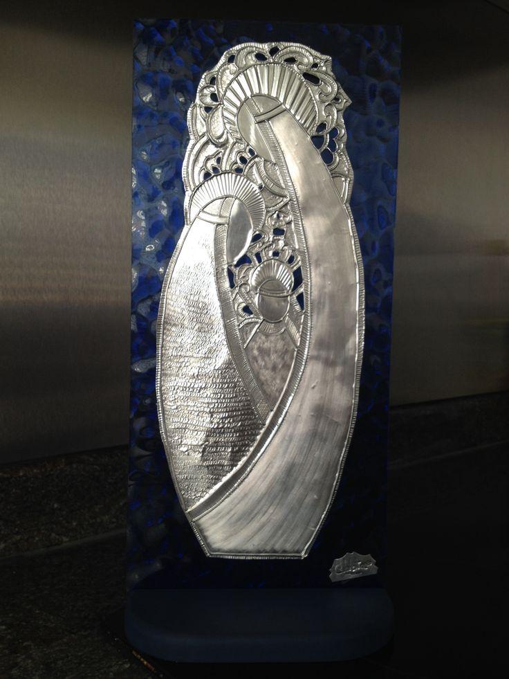 Pesebre repujado con base sobre vidrio de Carolina VP
