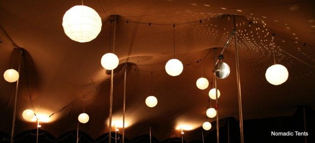 Inside of tent with lantern lighting