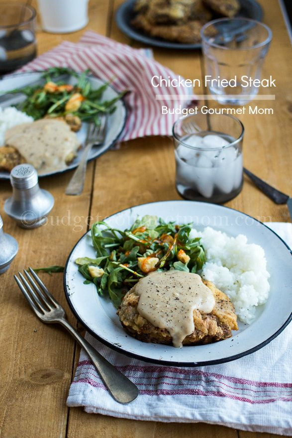 Chicken Fried Steak with Country Gravy... I made this tonight, one of my honey's favorite dishes. He liked it! :) I think though next time I will season the steak first. Never made C.F.S before but I will soon perfect this.