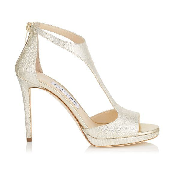 On SALE at 50.00% OFF! LANA 100 Dore Metallic Lamé Fabric T-Bar Sandals by Jimmy Choo. This simple and sexy T-Bar sandal provides a hint of glamour to take you from day to evening. Leather lined, with a l...