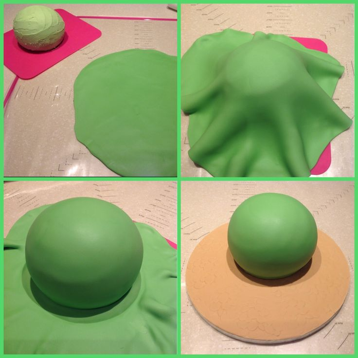 For Arlo the dinosaur's body, roll green fondant into a large circle and smooth onto the cake