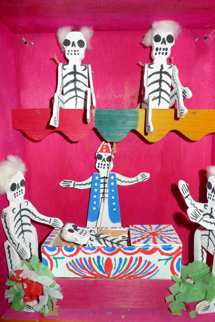 Skeleton theatre/ doll theatre made out of cardboard. Getting ready for the celebration of Dia de Muertos.