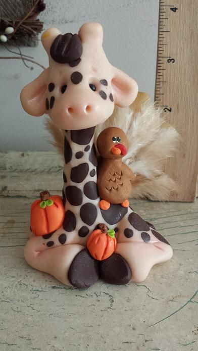 Polymer clay giraffe with a turkey friend. Hand sculpted by me Claykeepsakes (facebook page) come visit my page