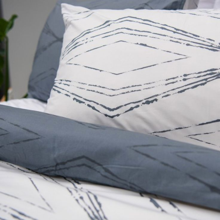 Just In! Our Antigua Quilt Cover Set is a geometric design of cool blue/grey and pure white. Highlighted by a geometric linear pattern it's sublimely sophisticated. QB set was $139.95 now $54.95
