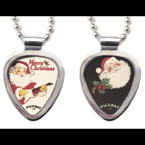"Pickbay Guitar Pick Holder + Santa Guitar Pick Pickbay is the BEST gift set! Hypoallergenic Stainless steel PICKBAY guitar pick holder pendant necklace set comes with a Retro Santa Xmas guitar pick plus 3+ cool guitar picks, a 24"" hypoallergenic stainless steel bigger ball chain all packaged together in a velvet polishing pouch, ready for gift giving! The gift they will wear forever! Ships from Los Angeles. Pickbay.com Jewelry Necklaces"
