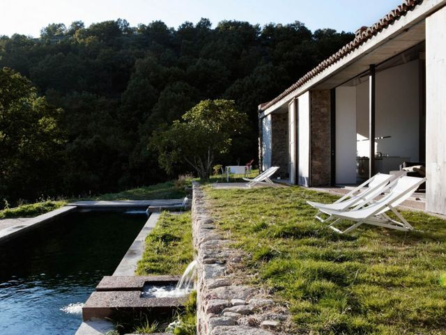Architectual firm Ábaton transformed an abandoned stable into a gorgeous stone estate in the province of Cáceres, Spain.