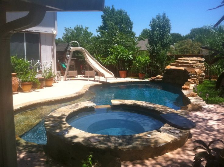 swimming pool Swiming Pool With Slide And Jacuzzi At Backyard How to Determine the Great Pool Builders