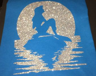 Little Mermaid Shirt, Under the Sea shirt Ariel Shirt Ariel Mermaid Shirts Little Mermaid Glitter Mermaid Ariel shirt  This listing is for a Little Mermaid Under the Moon Silhouette Shirt. It is done in a beautiful glitter color. You can chose to change the color of the shirt and glitter. Chose the shirt color in the drop down menu and in the notes section you can leave your choice of glitter design.  Glitter Choices: gold, silver, red, purple, white, black, pink, hot pink, yellow, green…