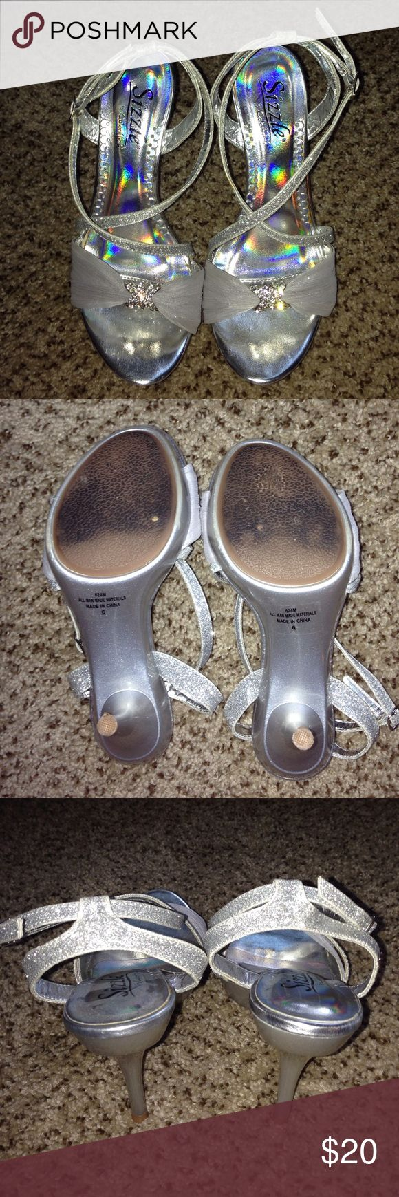 Silver bridesmaid shoes Worn once for a wedding. The only flaw is some of the glitter rubbed off on the left shoe where the straps cross (last pic). Heel is approx. 4 inches. Sizzle by Coloriffics Shoes Heels