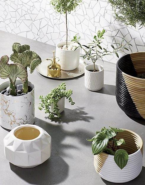 houseplant perfect. Color cuts a diagonal graphic across natural rattan. Tin liner hidden inside makes for 100% watertight planter.