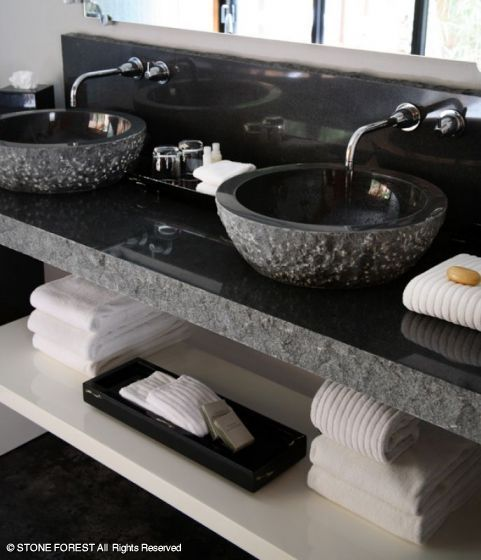 The Gaige House Spa features Asian-inspired ambiance combined with modern luxury.  Love the faucets (have these in our powder bath), love the basins, love the finish on the edge of the counter.