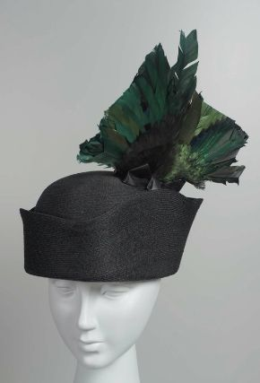 Hat -- Circa 1910-15 -- Likely French -- Woven black lacquered straw, trimmed w/ iridescent bird wings -- Museum of Fine Arts, Boston.
